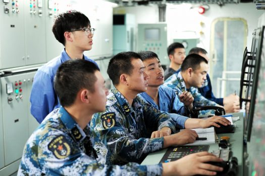 Chinese military working on board China's first domestically manufactured aircraft carrier.