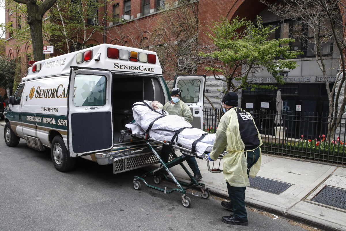 A patient is loaded into the back of an ambulance