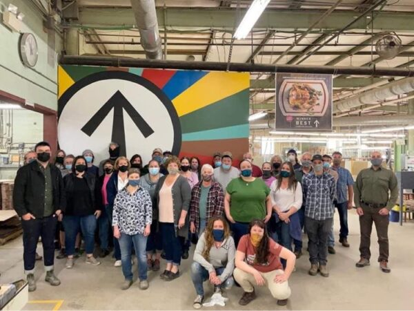Masked employees of JK Adams in Dorset, VT pose for a group photo. (Photo courtesy of JK Adams Facebook Page)